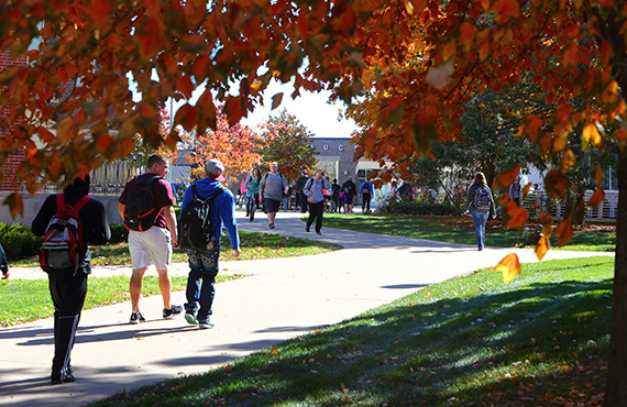 Students walking around campus during the Fall