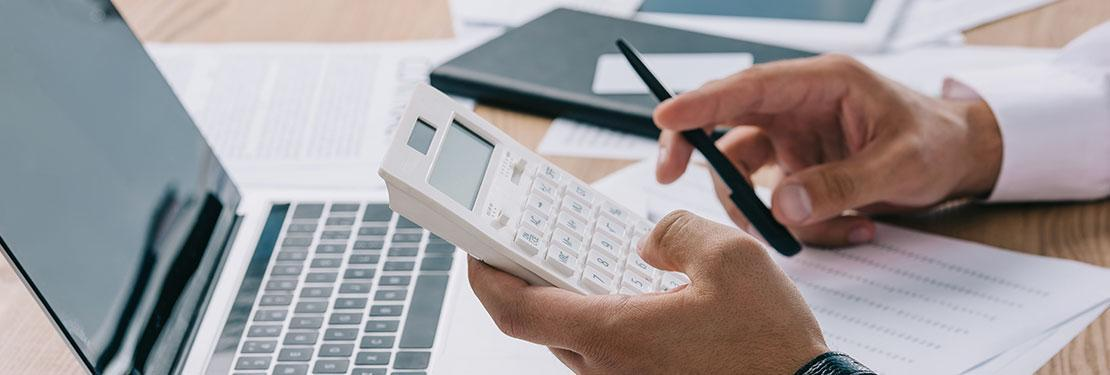 Accountant holding calculator