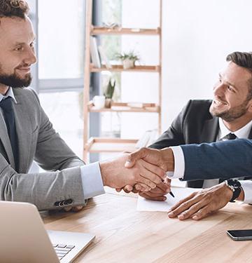 Sales professionals shaking hands